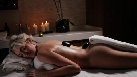 679135046-massage-oil-neck-nape-hot-stone-massage-massage-table